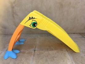 Yellow outdoor slide, for pre-school age children