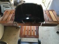 Charcoal hooded BBQ with cover.