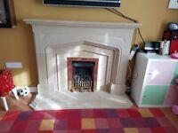 Limestone fireplace and gas fire