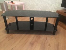 Black Glass Television stand, excellent condition.
