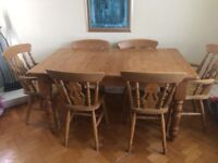 Solid pine dining table and 6 chairs . Table extends to fit 8 people