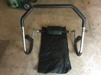 Ab roller with attached mat and head rest and arm rests