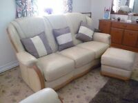Three piece suite: 3 seater settee; chair; pouffe. Cream leather/wood trimming. Excellent condition