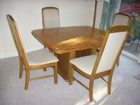 Dining table and 4 chairs in solid American oak.
