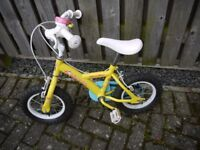 Halfords apollo sugar and spice 12 inch bike. Complete with stabilisers and pink bell!