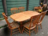 Extending pine table and six pine chairs