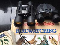 Two pairs of Binoculars and three books bird watching etc