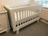 White cot bed and baby changer