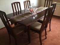 Mahogany extending dining table and six chairs