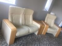 Reclining leather two seater sofa, swivel chair, chair, foot stool and glass table with stools