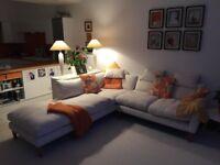 Light cream fabric sofa with foot stool