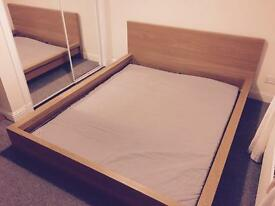 Ikea Malm king size bed frame with slats and topper.