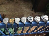 Various used golf clubs and bag
