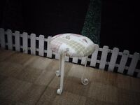 BEAUTIFUL VINTAGE STOOL COVERED WITH A REALLY NICE FABRIC AND WITH CAST IRON LEGS