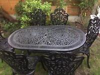 Oval garden table and six chairs