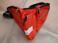Brand new Royal Canin bum bag which holds drinks container with toggle & 2 zippable c