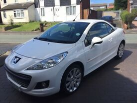White Peugeot 207cc, Allure model. 2010 Reg, FSH, last service and MOT April 2016. 2 owners.