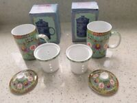 PAIR OF BOXED Beautufully decorated chinese tea mugs, infuser/strainer & lids