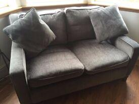 Two seater grey sofa