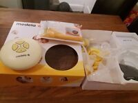 Medela swing breast feeding pump. Used, but in great condition and includes instructions.
