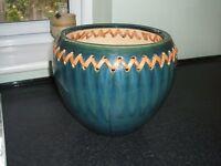 Blue glazed pottery plant holder. 23 cm high and 23 cm diameter.