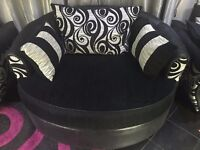 Black and white circular sofa, which rotates left and right 360 Degrees.