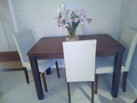 Table and cream chairs