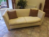 Ivory coloured textured fabric settee + 2 cushions