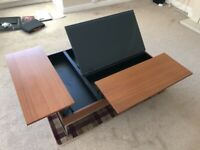 BoConcepts coffee table with 3 storage compartments/rising drinks rests