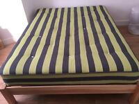 Kingsize wooden bed and luxury mattress