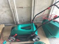 Bosch lawn mower and trimmer set. Bought 7 months ago