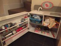 Pretty children's play kitchen with accessories