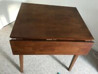 Dark wood extendable table. - £90 ono