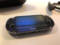 Playstation PS Vita 16Gb with case and hand grip. CoD theme on the back. Perfect condition.
