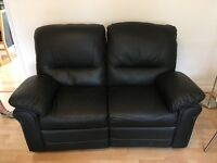 Genuine black leather... two seater recliner sofa...hardly used