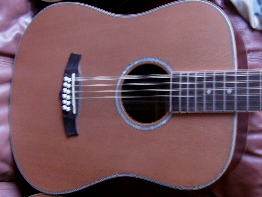 tanglewood solid top 12 string electro acoustic