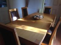 Light oak veneer rectangular Dining table with 6 chairs.