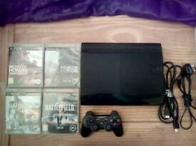 Ps3 with controller and games.