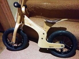 Early Rider wooden balance bike, very lightweight but sturdy and looks really cool too.