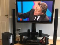50inch Panasonic tv, with black glass tv stand and home cinema system