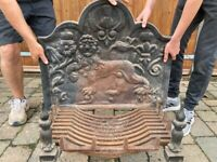 Cast iron fire back plate with dogs and basket
