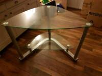 Glass corner desk.