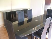 Clear and black glass dining table and 6 chairs.
