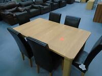 Ex Display Extendable Table And 4 Black Leather Chairs. Already Built And Can Deliver
