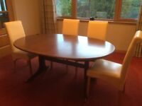 G Plan Dining Table with centre extension leaf. Ideal for up cycling . Protective cover included.