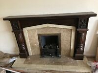 Gas fire with solid wood surround