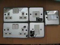 5 different electrical wall sockets,
