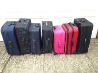 SEVEN UPRIGHT TWO WHEELED SUITCASES - USED - COLLECT FROM RADLETT HERTFORDSHIRE