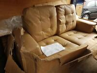 BRAND NEW LEATHER SOFA IN THE BOX UNUSED 2 SEATER
