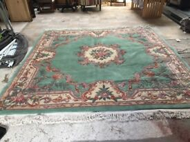 Green flowered rug